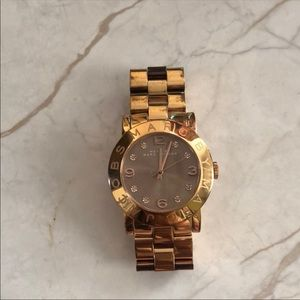 Marc Jacobs rose gold watch.